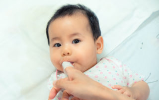 Wipe baby's teeth with a soft cloth