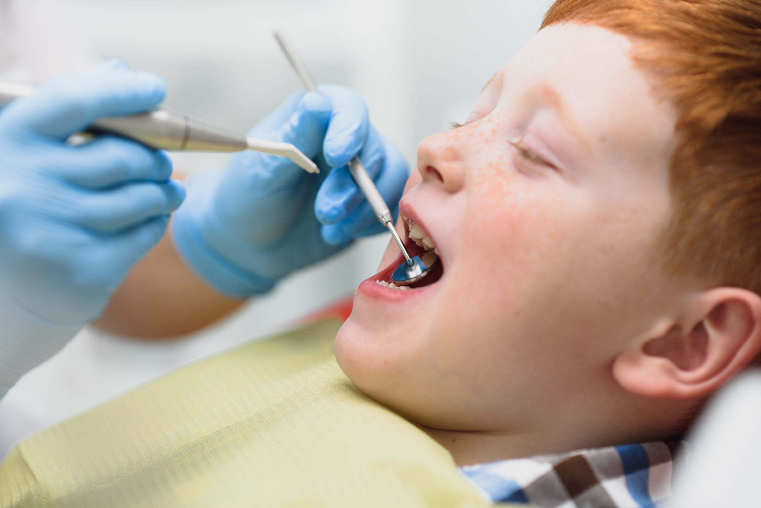 Boy satisfied with the service in the dental office.